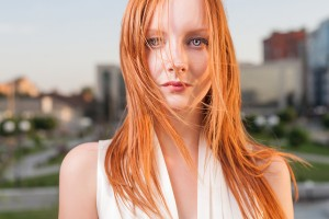 Portrait of freckled young woman cityscape