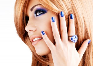 portrait of a beautiful woman with blue nails, blue makeup and r